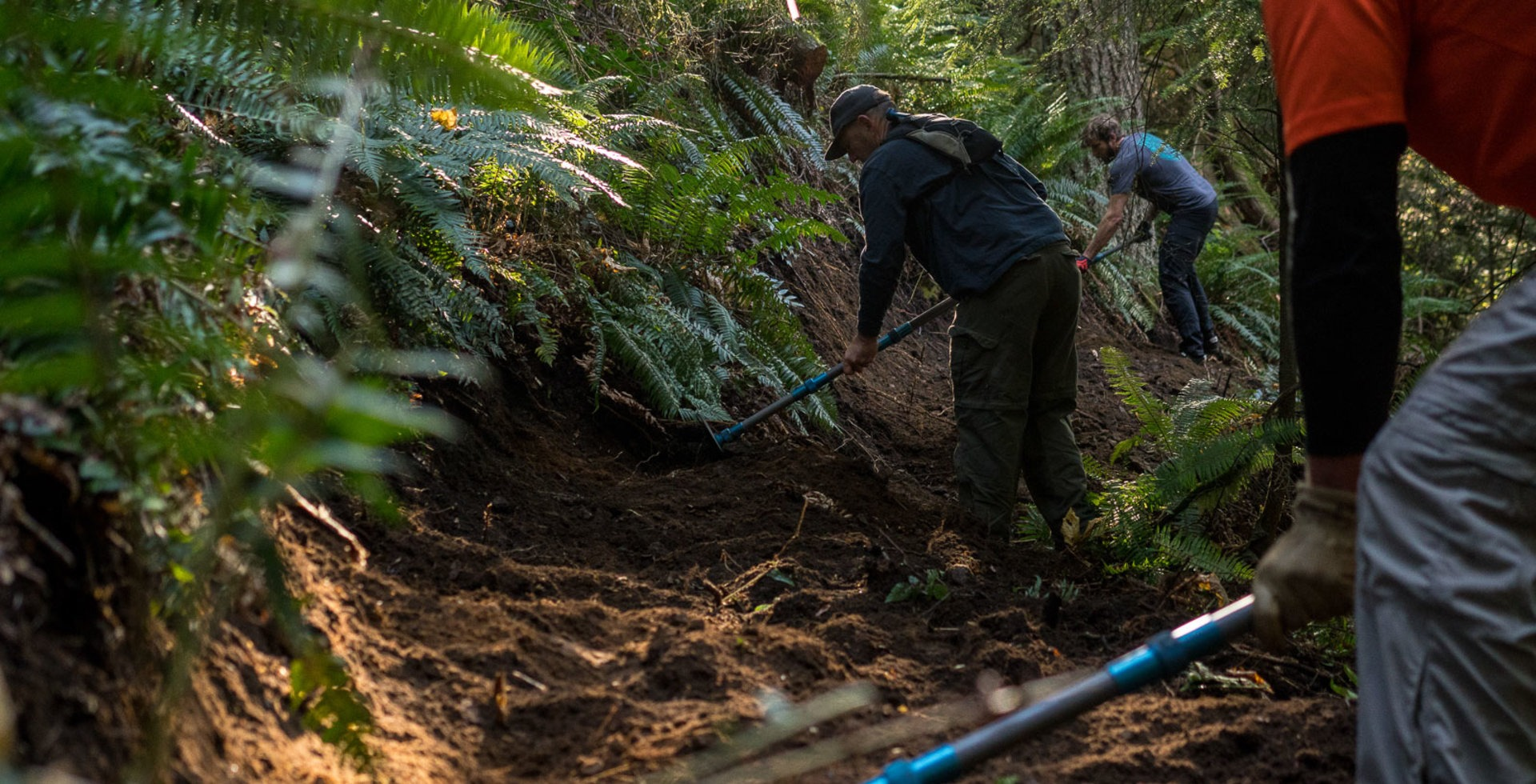 Bill Hasenjager, owner of TrailBoss, and Brandon Watts, publisher of Freehub Magazine, are both staples in the Bellingham mountain bike scene and move some dirt!