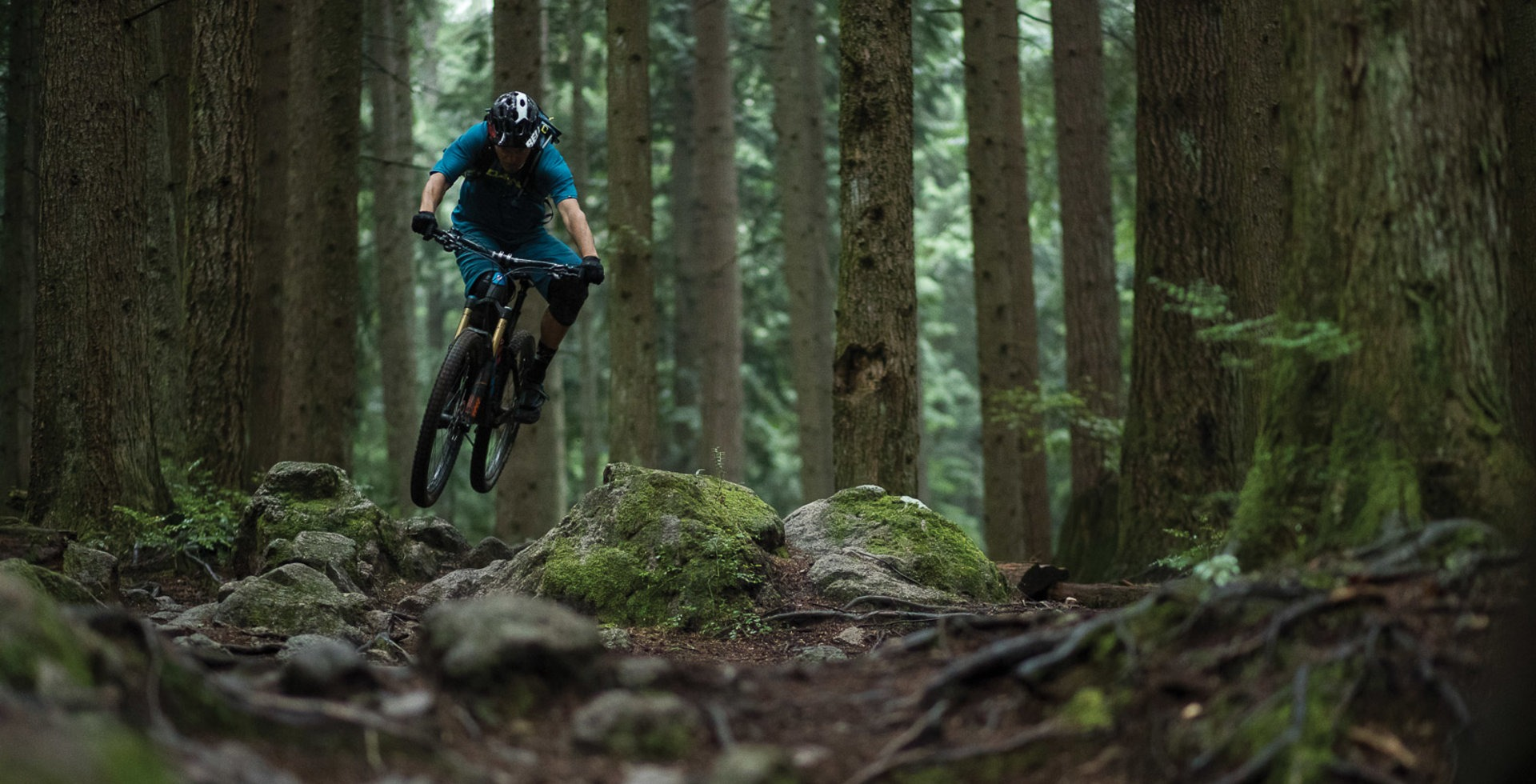 Mt. Fromme's trails aren't the highest-speed around, but they are certainly in the running for most technical--a heavy claim on the North Shore. That doesn't mean you can't send on Fromm, as four-time Canadian National Champion Andrew Shandro Proves.<br>CANON, 1/640 sec, f/1.8, IS0 3200
