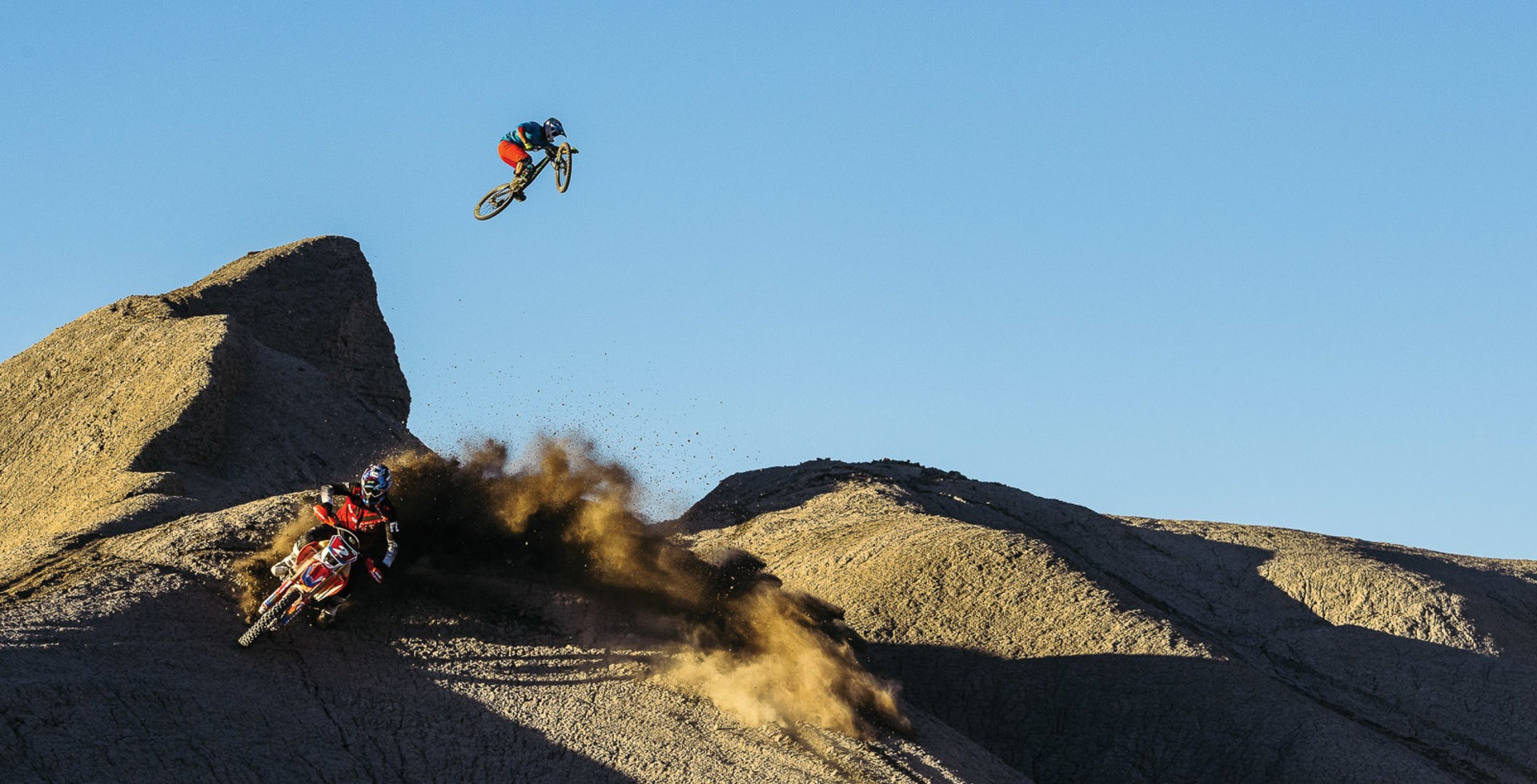 What happens when a professional mountain biker and moto rally racer join forces in the desert? An all-out throwdown on every feature in sight. Darren sends a gap that took a few hours to build, while Ricky roosts a berm that took a few seconds to destroy.