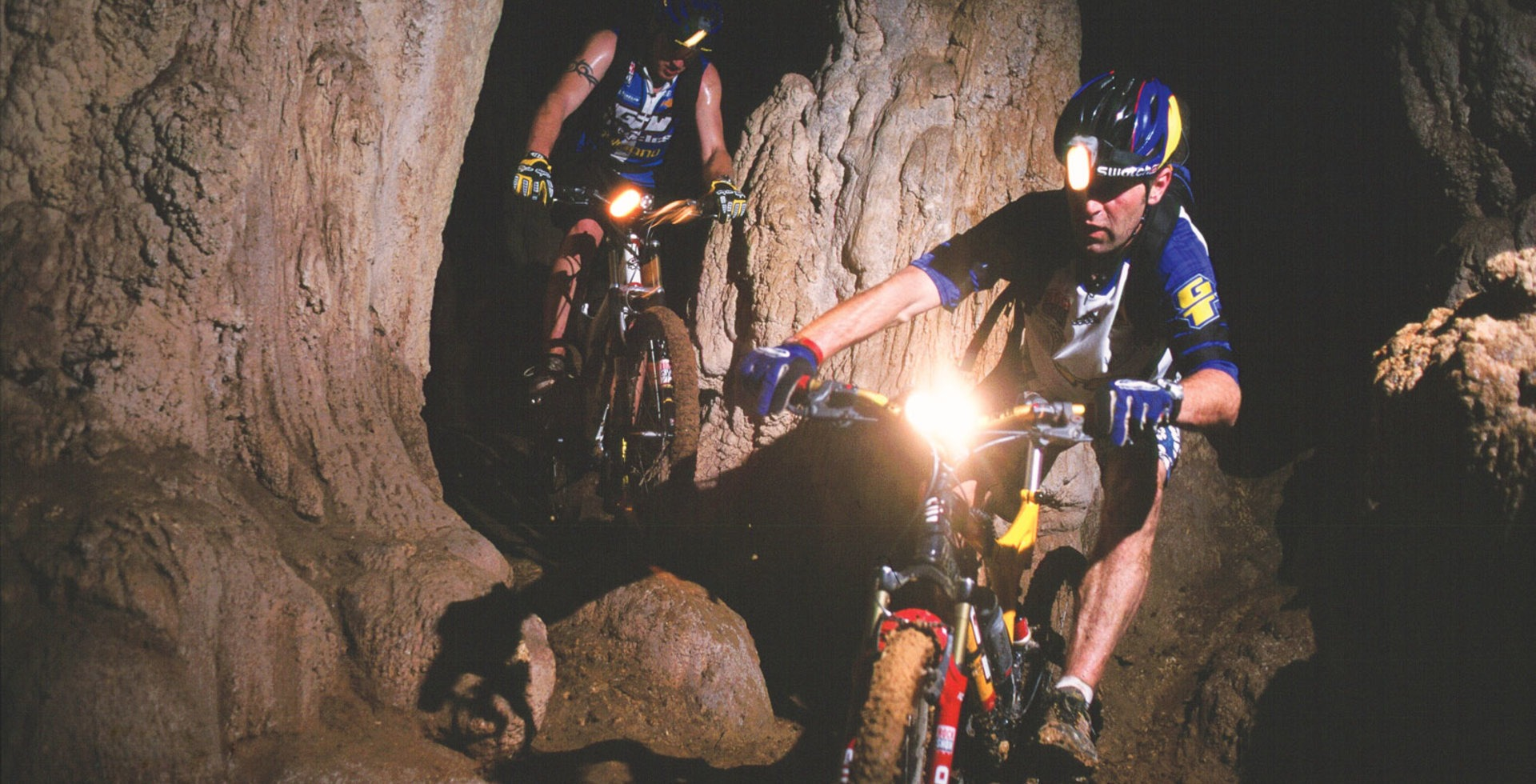 """""""Steve Peat and I went searching for headhunters in the jungles of Borneo, riding through one of the massive limestone caves inhabited by millions of bats. Spirits got the better of us on this trip."""" Photo: Stefan Eisend"""