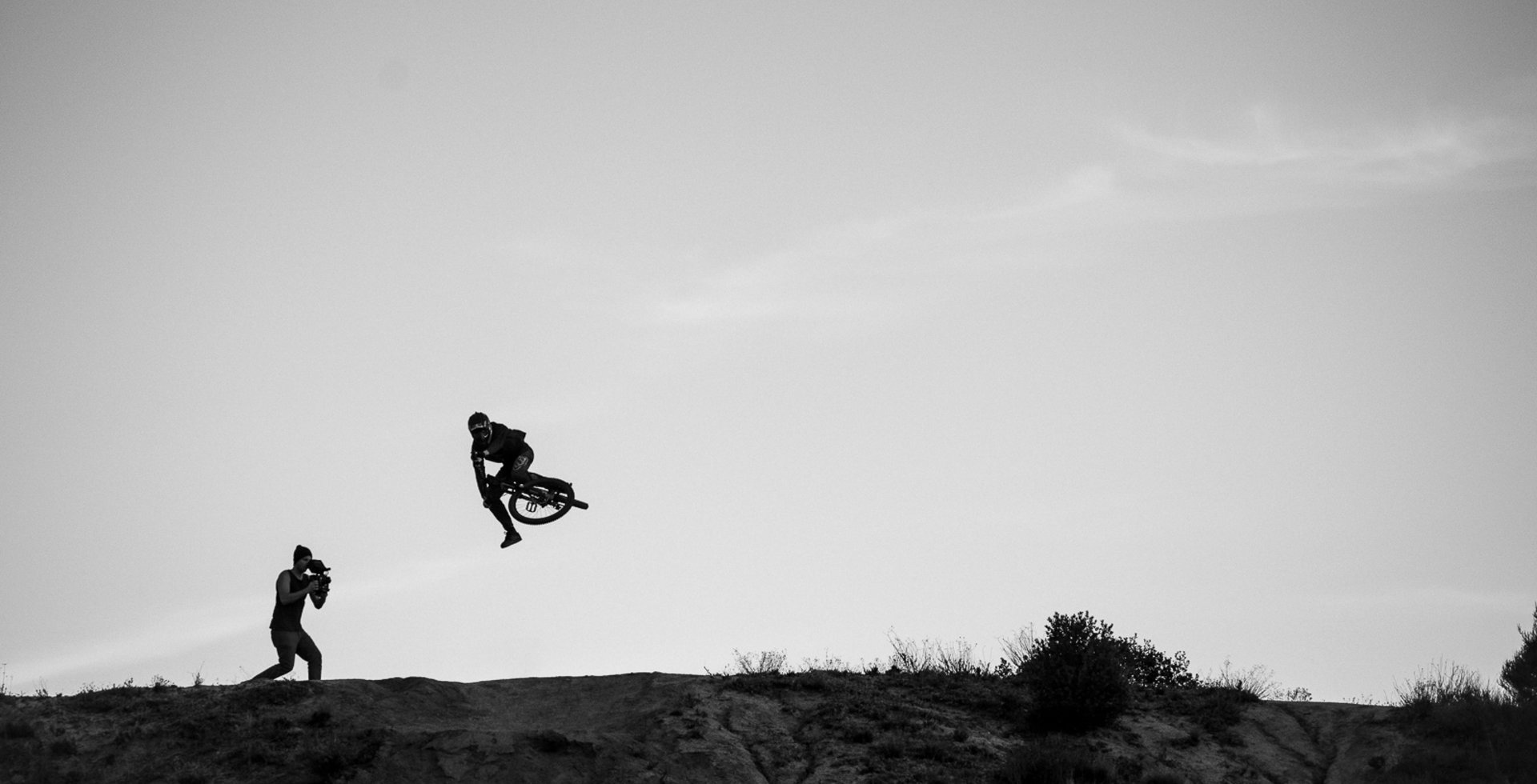 """Clay Porter, guest filming a 'Life Behind Bars' segment at the jumps in Pine Valley, CA. This is Brandon Semenuk sending at last light, but Nico Vink and Brendan 'Brendog' Fairclough were also there. This was the very beginning of 2014, and I honestly couldn't believe I was shooting these three guys just 45 minutes from my house. This shoot was the first time I'd worked with Brandon."""