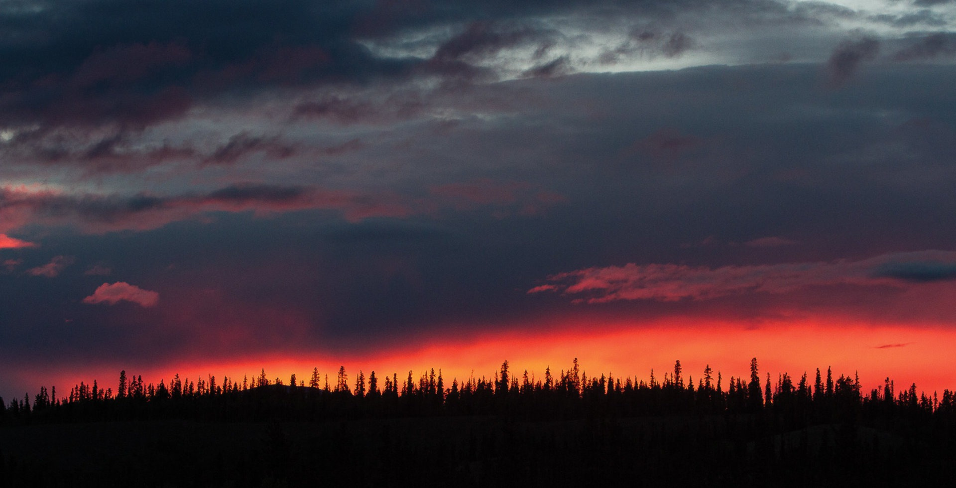 Sunsets in the Yukon never seem to end - which makes sense considering daylight can last 19 hours. A particularly colorful evening, viewed from the hot tub at the Boreale Ranch.