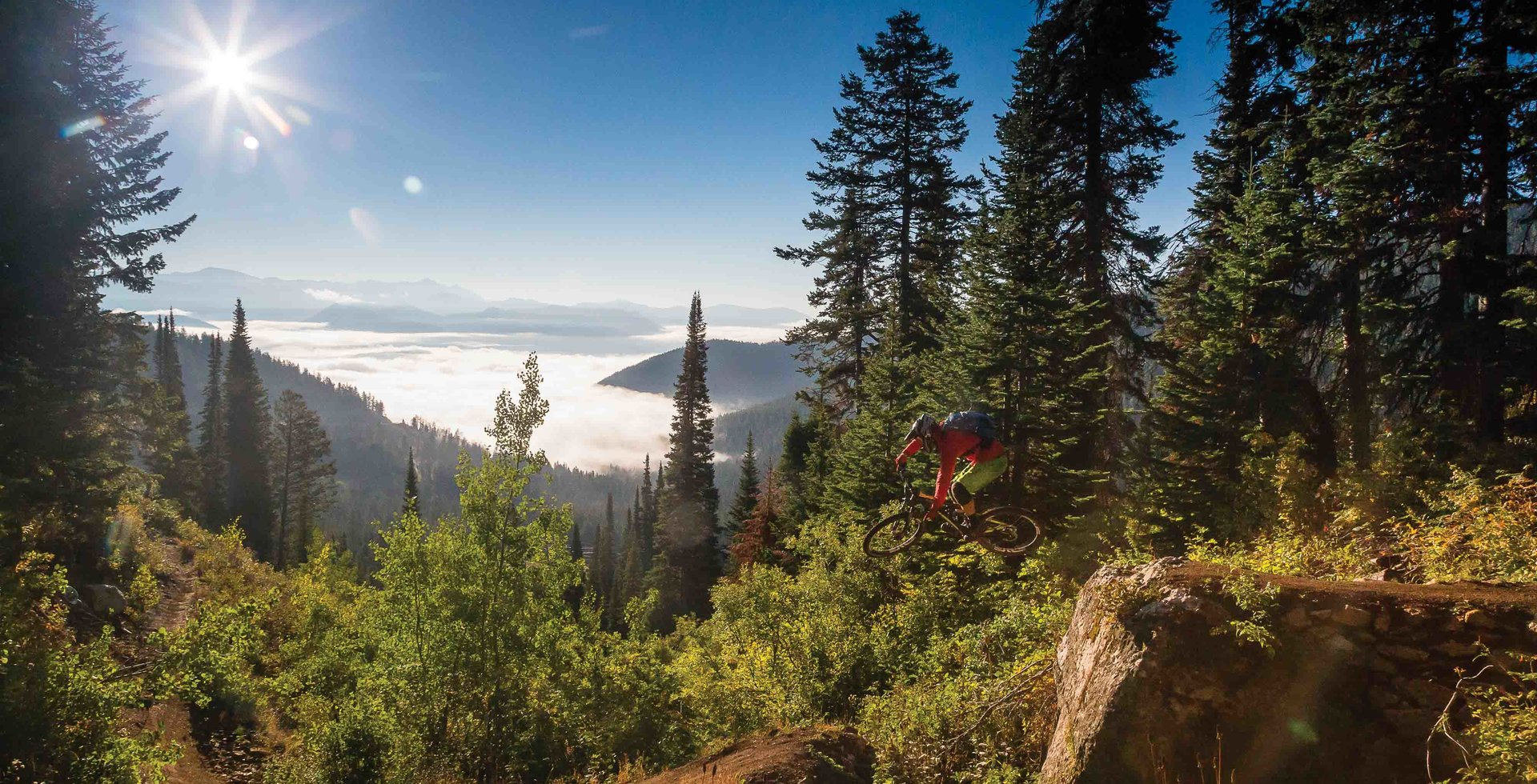 Teton Pass' Fuzzy Bunny Trail might sound cute and fluffy, but there are plenty of moves that can eat even experienced riders. Andrew Whiteford risks life and limb while sending one of the trail's many gaps, just as the fog rolls into the valley below.