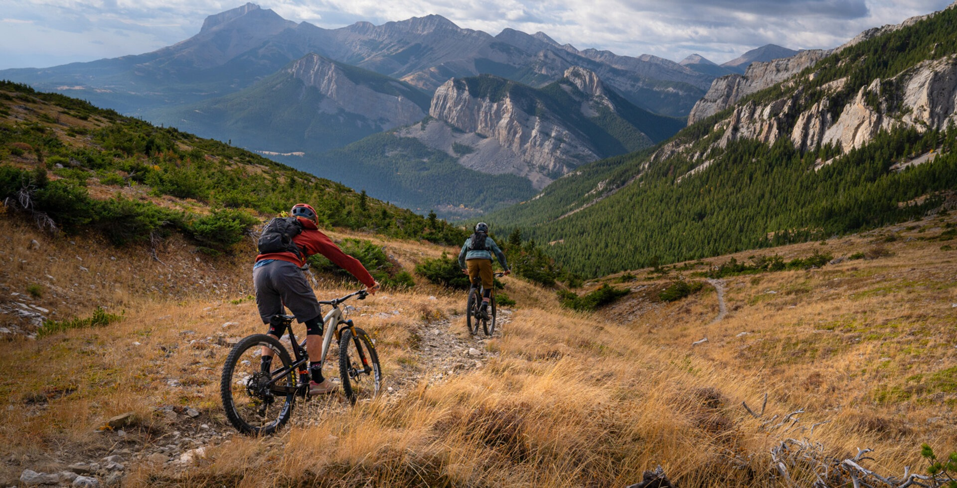 Sam Schultz and Eric Melson descend a particularly scenic section of backcountry singletrack near Montana's Bob Marshall Wilderness Complex in late autumn.