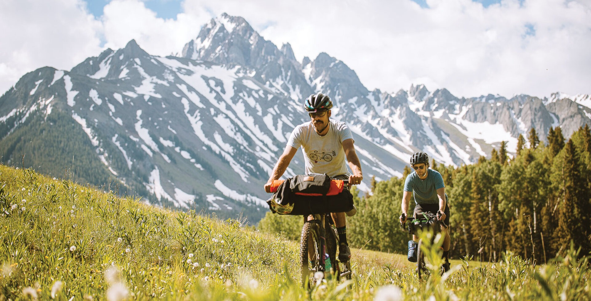 Covey Potter and Campbell Diebolt riding along the Dallas Divide in Southwest Colorado. Peaking at 8,983 feet, the divide 27 connects the San Juan Mountains and the Uncompahgre Plateau.