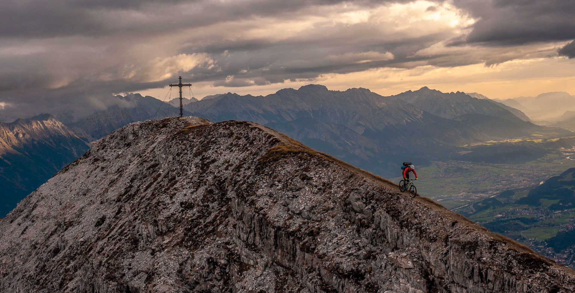 """""""Matthias Oehlboeck rides the ridgeline from the summit of Nockspitze after spending the night on the mountain. Enjoying a solitary, sunrise view over your hometown only makes you love it more, but with half of Innsbruck's population being addicted to the outdoors, you're rarely there by yourself. This particular night we shared the summit with three paragliders, who launched back to the valley the next morning."""" Photo: Andreas Vigl"""