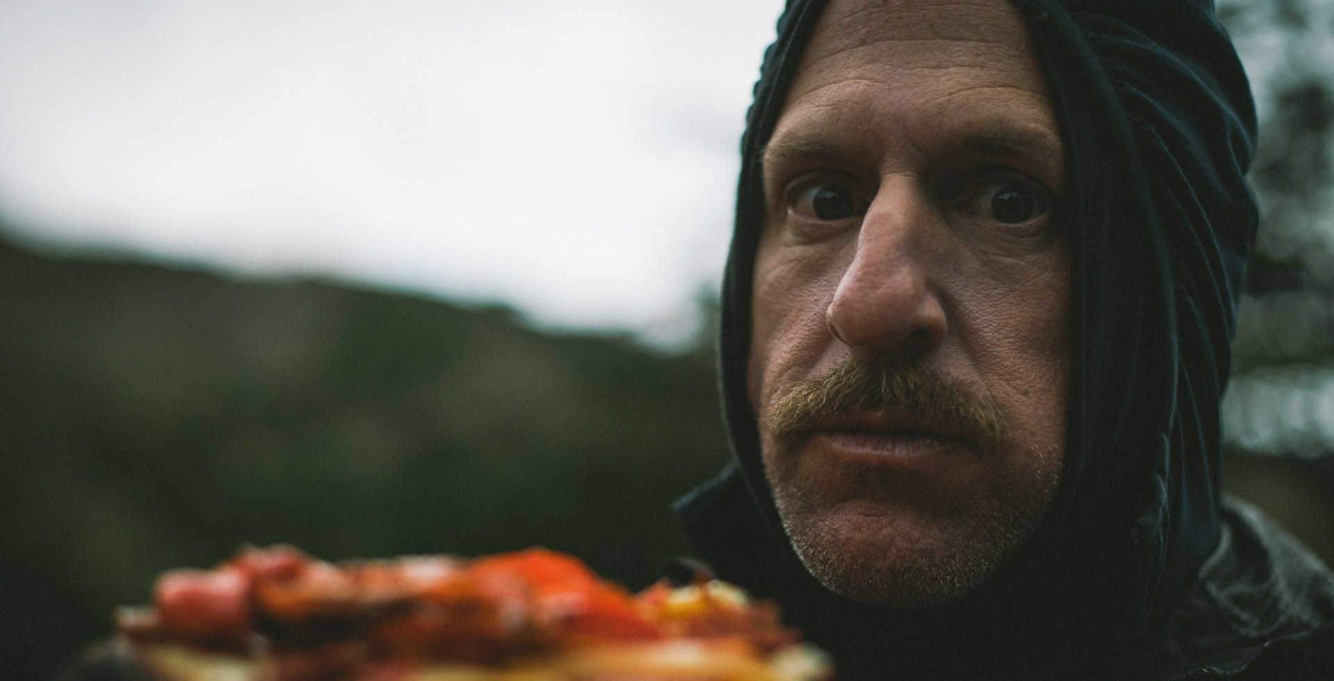 Brice Minnigh enjoying some fine dining in the mountains of Argentine Patagonia, on location with Anthill Films for a segment of the upcoming <i>Return to Earth</i> movie. Photo: Margus Riga