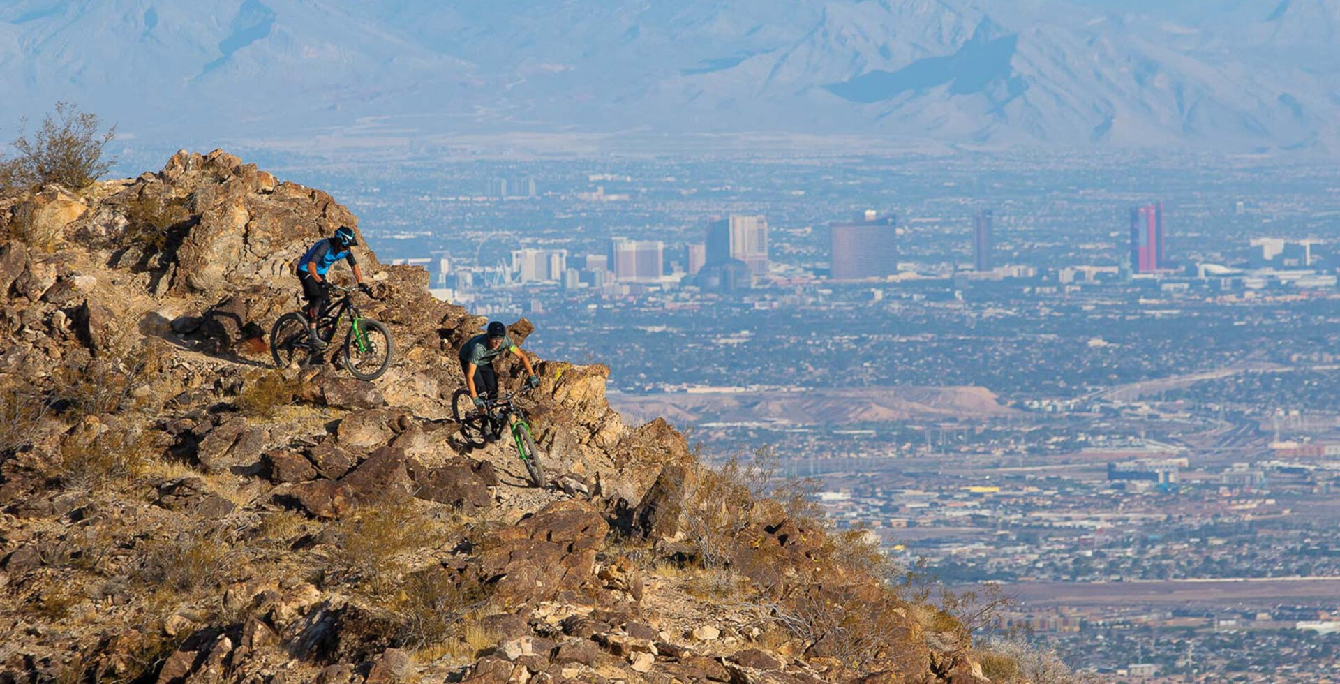 Bootleg Canyon is known for its brutal rock gardens, unrelenting terrain and advanced lines, which riders Joey Foresta and Brian Lopes make quick work of, as the Las Vegas Strip looms across the valley below.