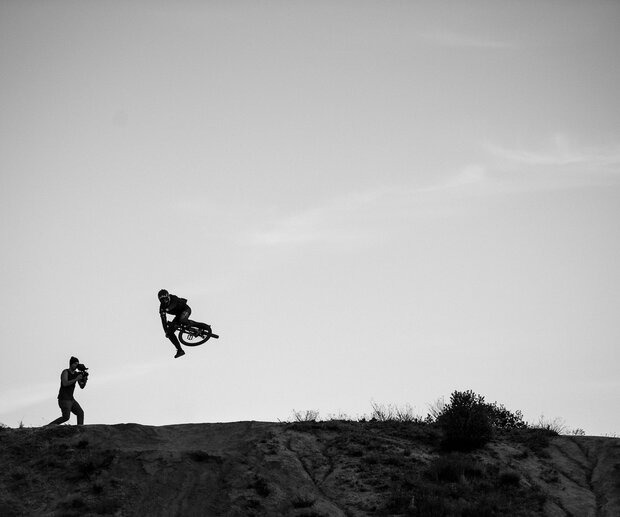 """""""Clay Porter, guest filming a 'Life Behind Bars' segment at the jumps in Pine Valley, CA. This is Brandon Semenuk sending at last light, but Nico Vink and Brendan 'Brendog' Fairclough were also there. This was the very beginning of 2014, and I honestly couldn't believe I was shooting these three guys just 45 minutes from my house. This shoot was the first time I'd worked with Brandon."""""""