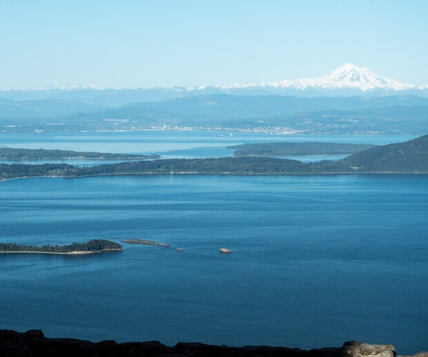 During a clear day on the summit of Mt. Constitution, it's possible to see Mt. Rainier, Glacier Peak, the Twin Sisters, Mt. Baker, the Canadian Coast Range, the Olympic Mountains, and, of course, Bellingham Bay, nearly 3,000 feet below. It's just one of the benefits of riding the highest point in Puget Sound.
