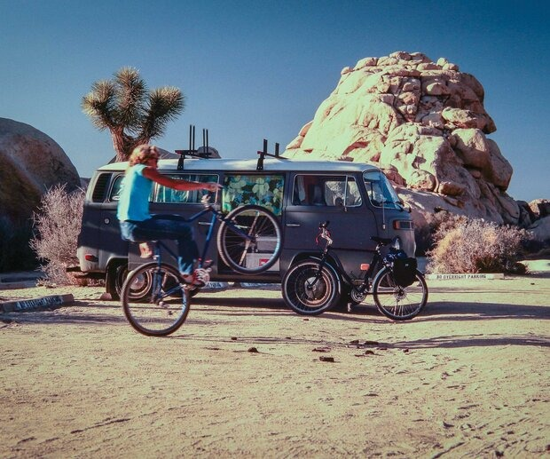 """Dave Wonderly said he always took his mountain bike along when he went climbing in Joshua Tree, a mecca for climbers from around the world, who congregate there every year in the off-season to hone their bouldering skills. For his two-minute sequence, I shot three 100-foot rolls of 16mm film—six minutes total—with my hand-crank Bolex and three fixed lenses in some of Dave's favorite rock formations."" Wonderly wheelies in front of Ruck's van in 1984, a decade before Joshua Tree was closed to mountain bikes."