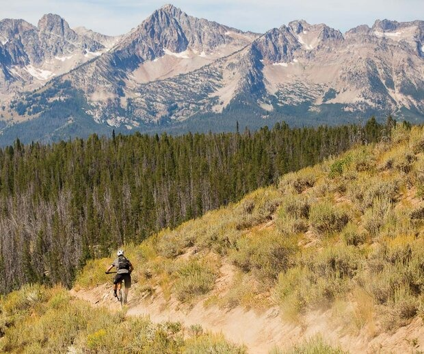 Eric Melson celebrates the fruits of his labor after a long climb on the Little Casino trail. The route, done in combination with Big Casino, is one of both extreme physical challenge and awe-inspiring beauty.