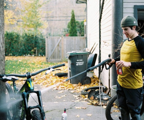"""""""Hero dirt"""" is a term often thrown around trailside, in parking lots and on internet forums. The riding conditions this fall in Squamish were the Webster's definition of """"Hero Dirt"""" if there is such a thing. Kozman cleans his rig after getting it sufficiently coated in the stuff."""