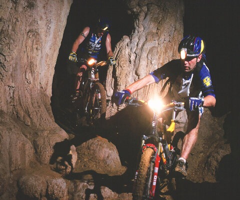 """Steve Peat and I went searching for headhunters in the jungles of Borneo, riding through one of the massive limestone caves inhabited by millions of bats. Spirits got the better of us on this trip."" Photo: Stefan Eisend"