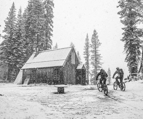 Nothing beats a warm fire and hot meal after a long, cold ride. Eric Porter and Kurt Gensheimer pedal out of a September snowstorm, eager to arrive at the evening's accommodations.