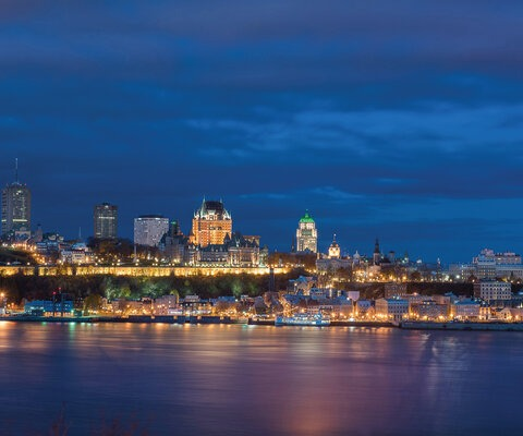 The Quebec City skyline is a mix of modern buildings and historic monuments, displaying the unique history and heritage of the region—and creating a beautiful reflection on the calm waters of the St. Lawrence river. The city's establishment on such a prominent river was crucial to its success as a trade hub and later played a big role in the ease of access to necessary timber resources. Photo courtesy of Ville de Québec.