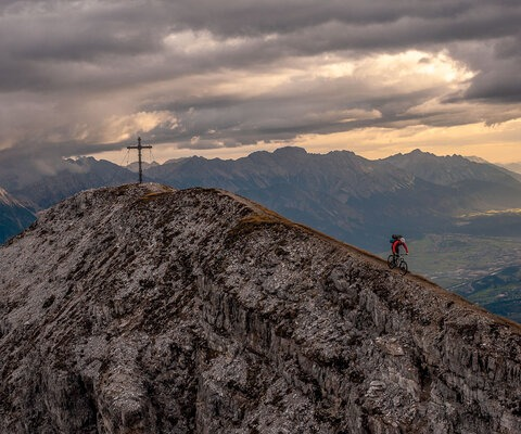 """Matthias Oehlboeck rides the ridgeline from the summit of Nockspitze after spending the night on the mountain. Enjoying a solitary, sunrise view over your hometown only makes you love it more, but with half of Innsbruck's population being addicted to the outdoors, you're rarely there by yourself. This particular night we shared the summit with three paragliders, who launched back to the valley the next morning."" Photo: Andreas Vigl"