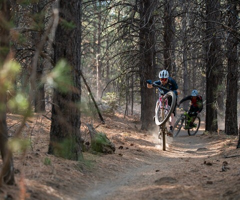 The way Kirt rides, he's more likely to have at least one wheel off the ground than two on it. A high-speed manual followed by his good friend Russ Risdon at home in Bend, OR. Photo: Jann Eberharter