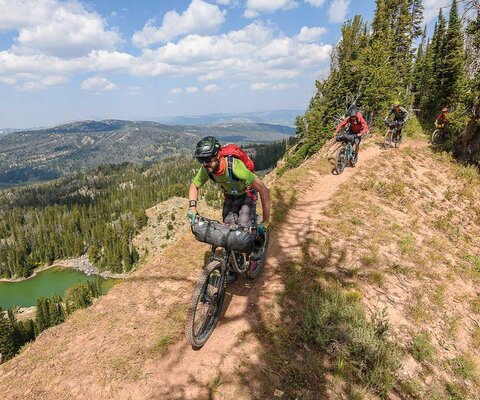 Chad Melis leads Carston Oliver and the rest of a six-person crew across an exposed ridgeline in Montana's Madison Range.