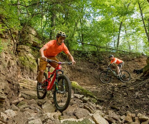 Rock Solid trailbuilders Jahmey Hamilton and Kyle McGurk put a section of fresh stonework to the test on War Eagle, one of the new lines they built on Grandad Bluff.