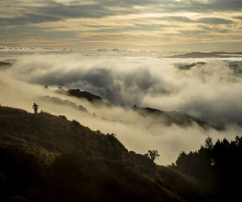 Early mornings at Tamarancho provide stunning views and often empty trails. Vernon Huffman starts the day off right as the clouds roll through the valley. Photo: Jann Eberharter