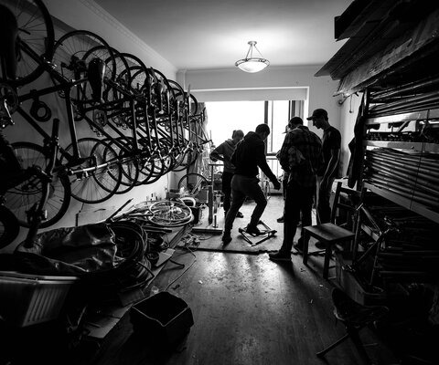 Abu Ren tests a frame at Simple Bikes' headquarters— as well as their warehouse and factory—in a small room on the 11th floor of an apartment complex in Chengdu, China.