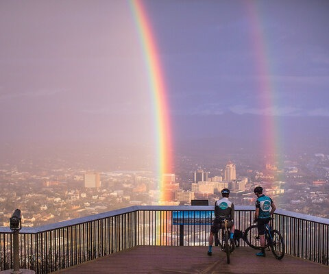 Gordon Wadsworth and Andrew Dunlap pause to take in a wild view of Roanoke from the Mill Mountain Lookout. Being minutes from town, Mill Mountain is the perfect place for a quick ride—although epic double rainbow views can't always be expected.