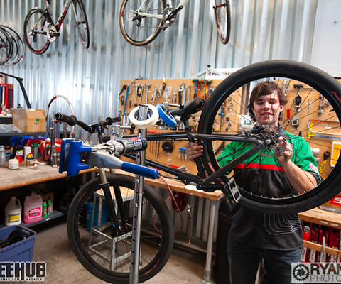 Cully Radvillas getting bike ready as he talks with us about his work at SRAM.